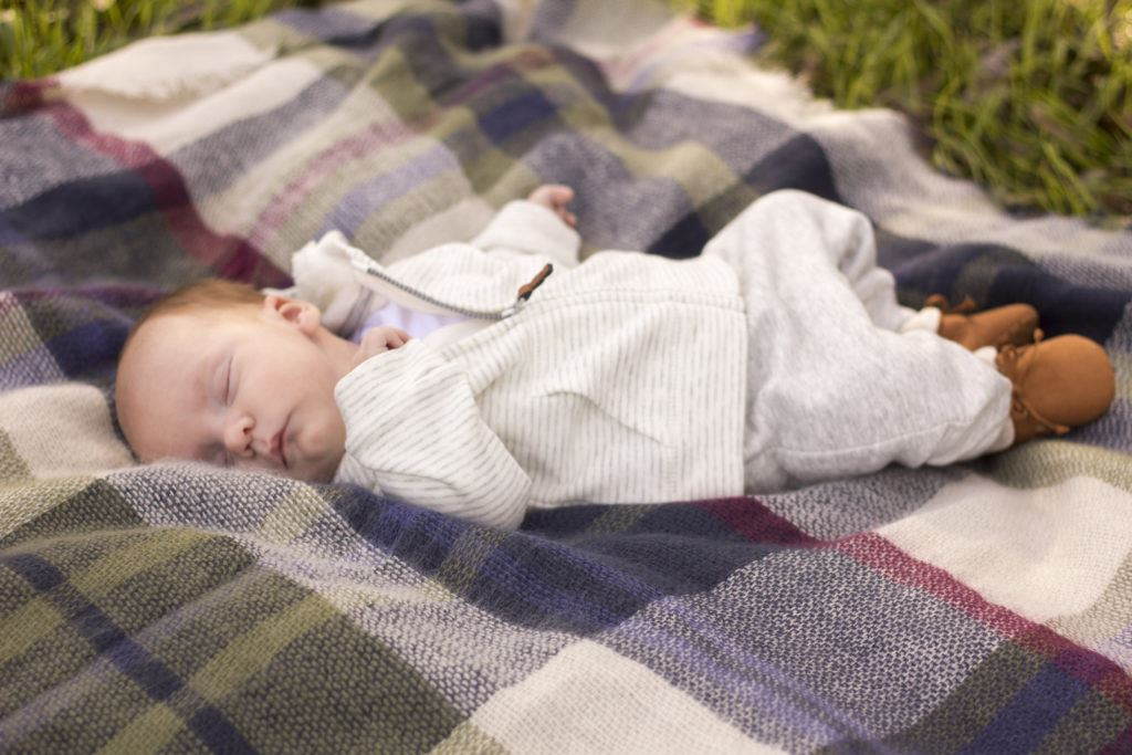 my youngest baby boy Ryan, laying on a blanket scarf for our Family pictures last year