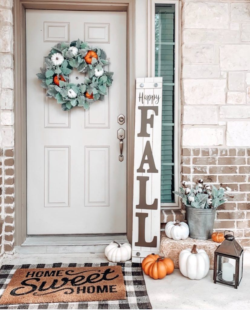 my front door Fall decor with a large Happy Fall ya'll sign, white and orange pumpkins and a wreath with lambs ear and pumpkins.