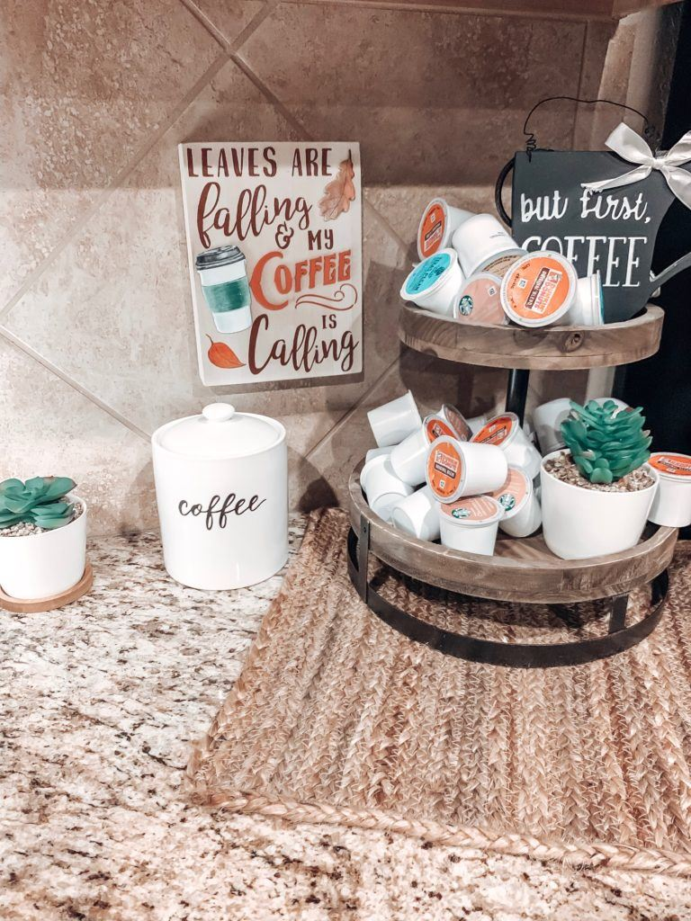 Two Tier wooden tray holds my favorite k cups with faux succulents to add a little greenery.