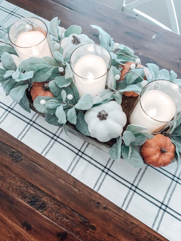 Dining room table scape adorned with a wooden bowl filled with faux white and orange mini pumpkins and lambs ear.