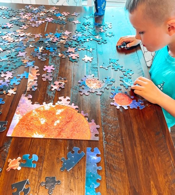 Ryder (my five year old ) working on an  Outer Space Puzzle we found on Amazon